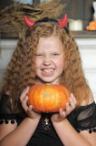 Evil  girl with pumpkin Royalty Free Stock Photo