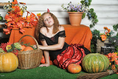 Evil girl with pumpkin Royalty Free Stock Photos