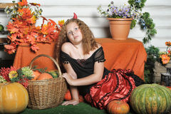 Evil girl with pumpkin Royalty Free Stock Images