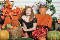 Evil girl with pumpkin Stock Photo
