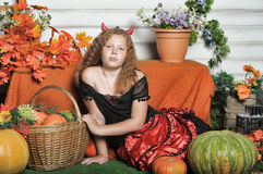 Evil girl with pumpkin Stock Photos