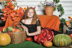 Evil  girl with pumpkin Royalty Free Stock Image