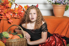 Evil girl with pumpkin Stock Photography