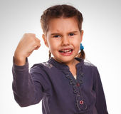 Evil girl shows fists experiencing anger and Royalty Free Stock Photo