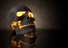 Evil Glowing Skull Perspective. A perspective view of a dark human skull with glowing orange insides on adark eerie background Royalty Free Stock Images