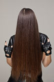 Evil hair. Woman with long hair covering her face Royalty Free Stock Photo