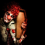 Evil Horrible Clown Holding Coffin In Darkness Royalty Free Stock Photo