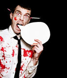 Evil Horror Zombie Shouting Out Halloween Message. Comical Photo Of A Evil Halloween Zombie Shouting Out A Horror Message Of Blood And Gore Through A Round Royalty Free Stock Photo