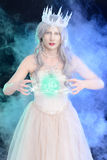 Evil ice queen with ball of magic Royalty Free Stock Image