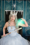Evil ice queen using magic Stock Photography