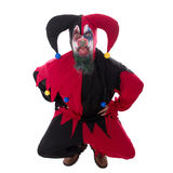 Evil jester sticking out the tounge, isolated on white Stock Photo