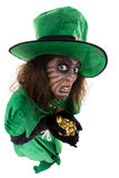 Evil leprechaun girl holding a treasure, concept Legends and Ire Royalty Free Stock Photo