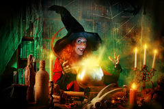 Evil magic. Fairy wicked witch in the wizarding lair. Magic. Halloween Royalty Free Stock Photography