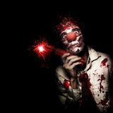 Evil Male Business Clown Holding Explosive Bomb Stock Images