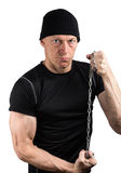 Evil man in black with chain tight in his hands Royalty Free Stock Images