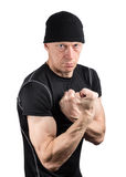 Evil man with clenched fists isolated on white Stock Image