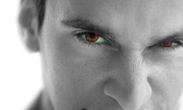 Evil man. With scary red eyes royalty free stock photography