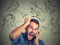 Evil men pointing at stressed anxious guy Stock Images