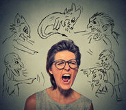 Evil men pointing at stressed frustrated screaming woman Royalty Free Stock Photos