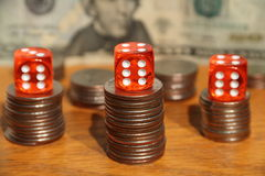 Evil money. Stacks of money with red dice showing the evil satanic numbers of 666 Stock Images