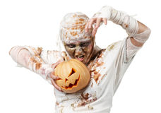 Evil mummy is holding  pumpkin Royalty Free Stock Image