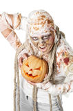 Evil mummy is holding  pumpkin Royalty Free Stock Photo