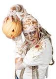 Evil mummy is holding  pumpkin Stock Image