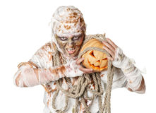 Evil mummy is holding  pumpkin Royalty Free Stock Photos