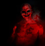 Evil On My Mind. An evil psychotic clown covered in blood Royalty Free Stock Photo