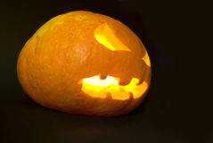 Evil Pumpkin. Head with light inside in complete darkness royalty free stock photo