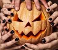 Evil pumpkin with glowing eyes that are holding Stock Photography