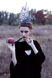 Evil queen with an apple Royalty Free Stock Images