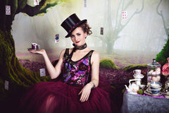 Evil Queen in bowler and a cup of tea Royalty Free Stock Photos