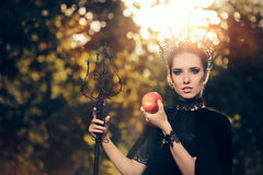 Evil Queen with Poisoned  Apple in Fantasy Portrait Royalty Free Stock Images