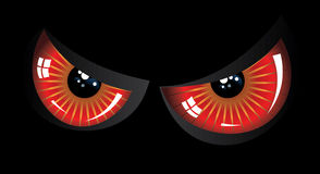 Evil red eyes. Cartoon evil red eyes on black background Stock Photos
