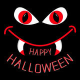 Evil red eyes and mouth with fangs at night. Happy Halloween card Royalty Free Stock Photo