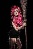 Evil red-haired witch and her broomstick Royalty Free Stock Image
