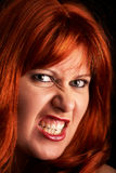 Evil red-head woman. Evil red head woman looking Stock Image
