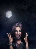 Evil rock-star woman Stock Photography