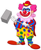 Evil scary clown. Holding a hammer Stock Image