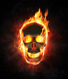 Evil skull in flames and smoke Stock Images