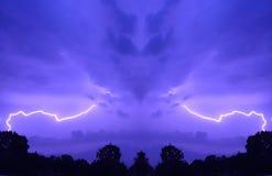 Purple sky with lightning. Mirrored purple stormy sky with lightning strikes Stock Image