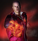 Evil sorcerer. 3d render of an evil sorcerer preparing a fire spell attack Royalty Free Stock Photography