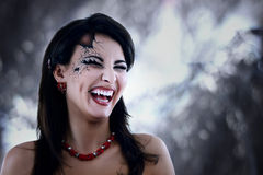 Evil vampire woman beautiful halloween. Over night background Royalty Free Stock Photography