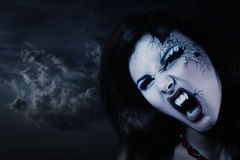 Evil vampire woman beautiful halloween. Over night background Royalty Free Stock Images