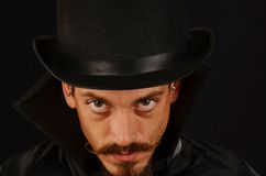 Evil Villain. With top hat and cape Royalty Free Stock Photography