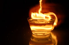 Evil water. Water with fire in glass bowl Stock Photos