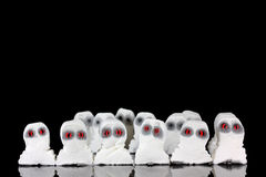 Evil white ghosts in a crowd. With black space stock image