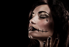 Evil witch on black background Stock Images