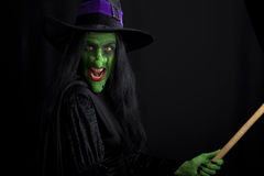 Evil witch on a broomstick stock photos